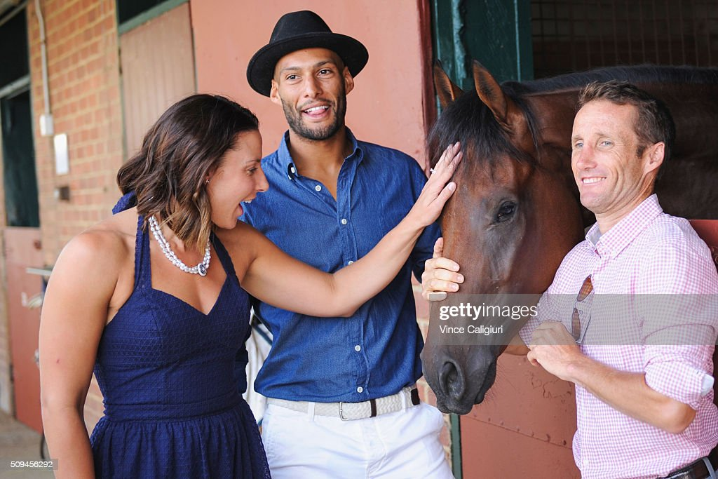 Relaxed Racing Ambassadors, Hawthorn footballer Josh Gibson and Melbourne Vixens Captain Madi Robinson pose with jockey <a gi-track='captionPersonalityLinkClicked' href=/galleries/search?phrase=Damien+Oliver&family=editorial&specificpeople=210504 ng-click='$event.stopPropagation()'>Damien Oliver</a> holding Tailored during the launch of 'Relaxed Racing' carnival at Caulfield Racecourse on February 11, 2016 in Melbourne, Australia.