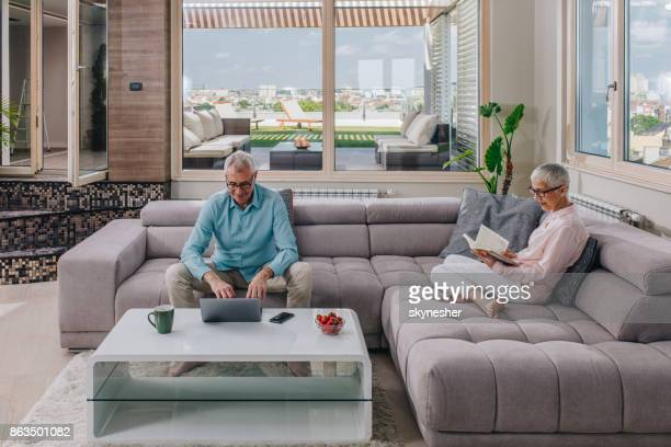Relaxed senior people spending their free time in the living room.
