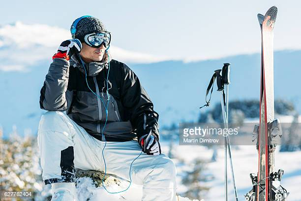 Relaxed skier enjoying the snowy mountain