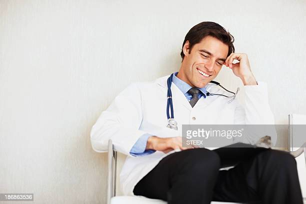 Relaxed smiling handsome male doctor