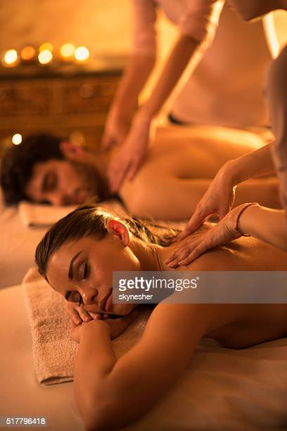 Relaxed woman enjoying in back massage at the spa.