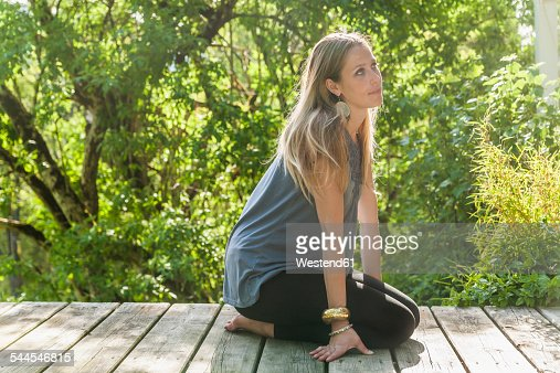 Relaxed woman on wooden terrace