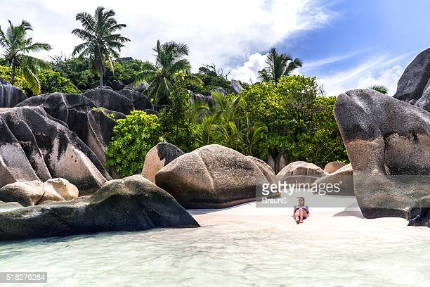 Relaxed woman sunbathing on La Digue island on Seychelles.