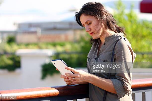 Relaxed woman using digital tablet