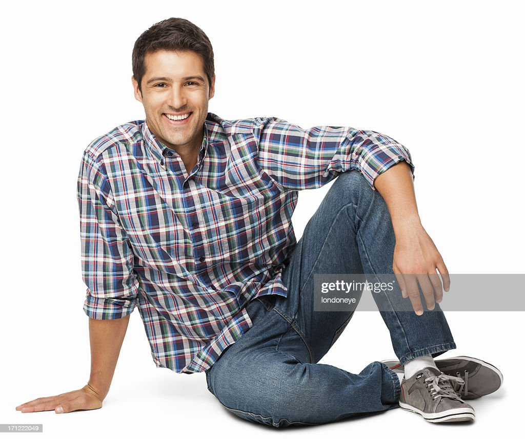 Relaxed Young Man Sitting On Floor - Isolated : Stock Photo