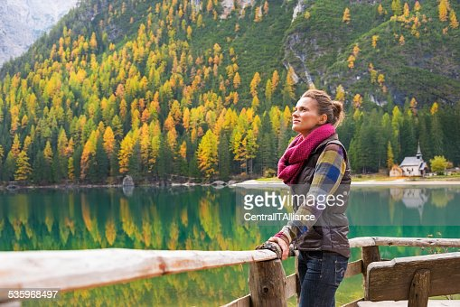 relaxed young woman on lake braies in south tyrol, italy : Stock Photo