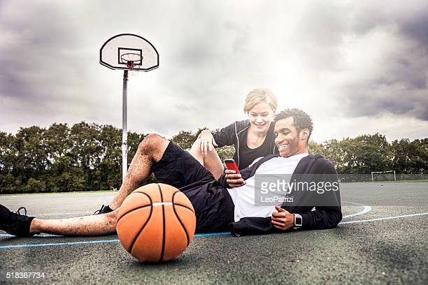 Relaxing after basketball match at playground