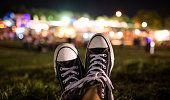 Feet up; overlooking a festival with lights.