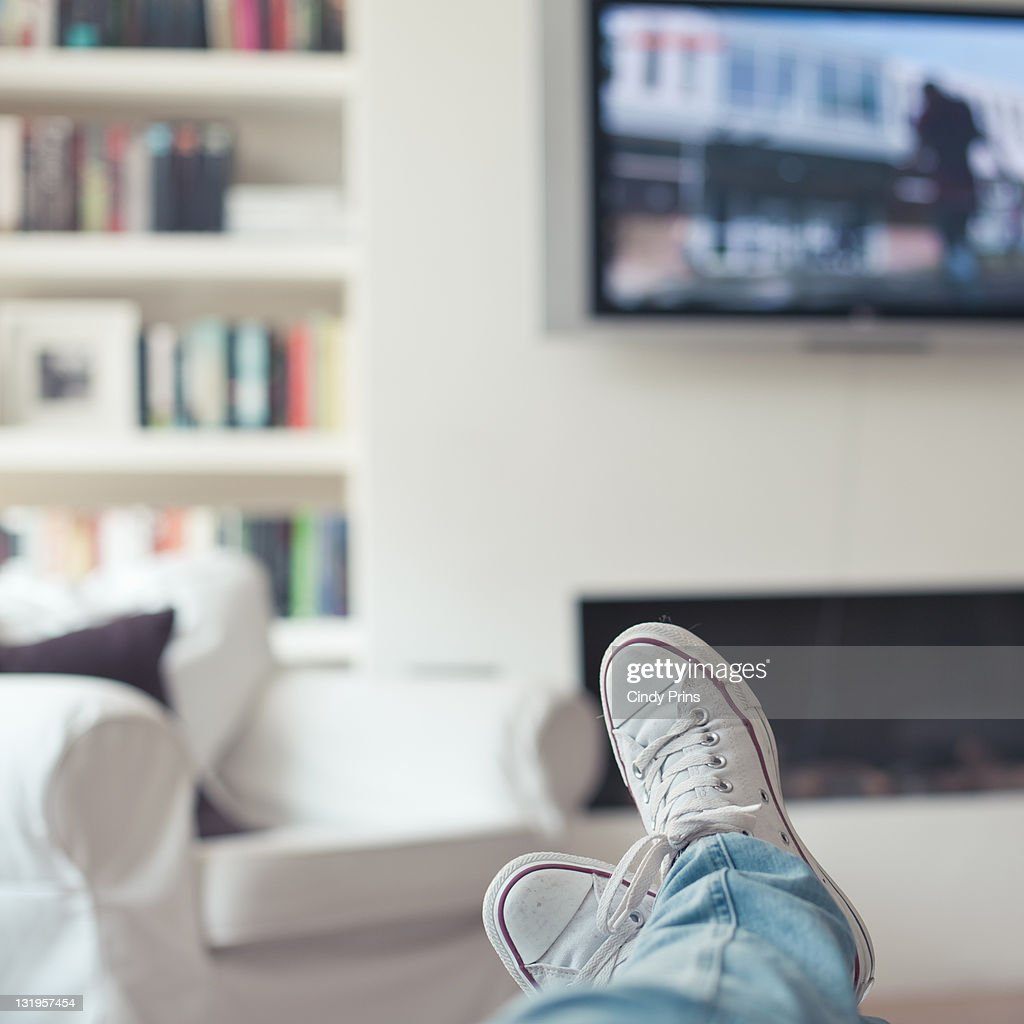 Relaxing at home, watching tv : Stock Photo