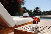 soft drink in a beach chair by the pool of a luxury hotel
