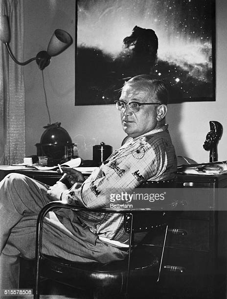Relaxing in his apartment in the University Club George Gamow takes five for a cigarette from the strenuous task of editing material for his college...