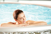 Portrait of a beautiful mid aged woman relaxing a me day in the hot tub.