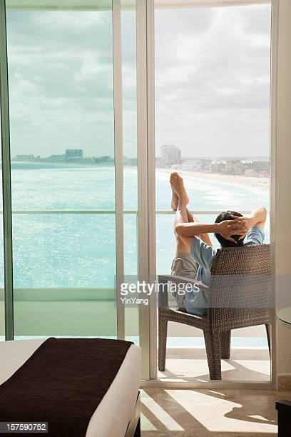 Relaxing Man on Hotel Room Balcony Enjoying Sea Beach View