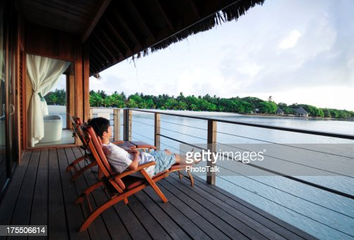 Relaxing On Deck Chair of Beach House - XLarge