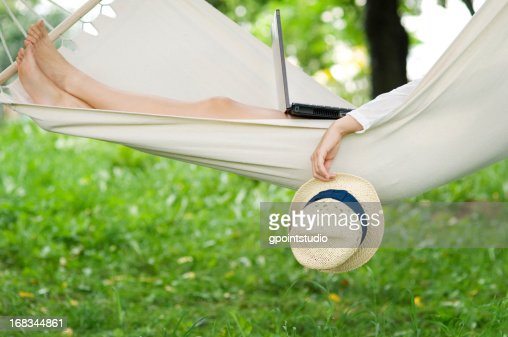 Relaxing on hammock with a laptop : Stock Photo