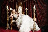 Relaxing queen on the throne. Joy, pleasure.