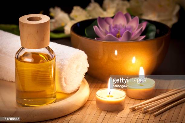 Relaxing table with aromatherapy supplies.