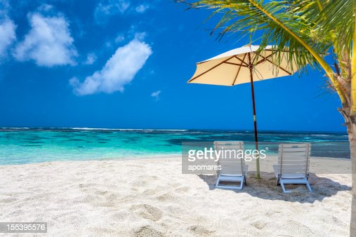 Caribbean Relaxation: Relaxing Tropical Caribbean Island Beach Umbrella And