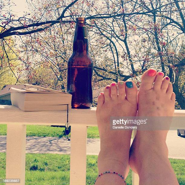 Relaxing with a book and a beer