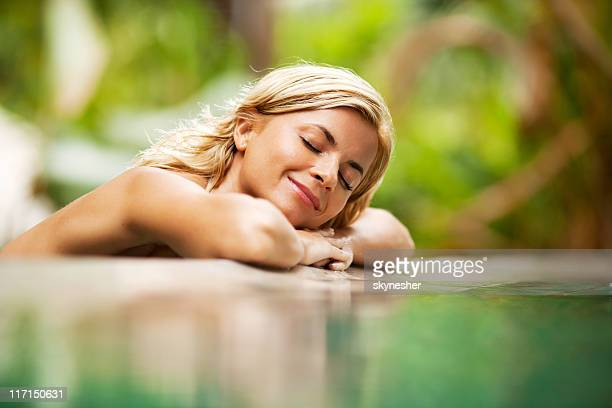 Relaxing woman near the water at nature.