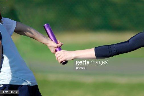 Relay race baton handoff. : Stock Photo