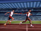 Relay race, male athletes passing relay baton (Digital Composite)