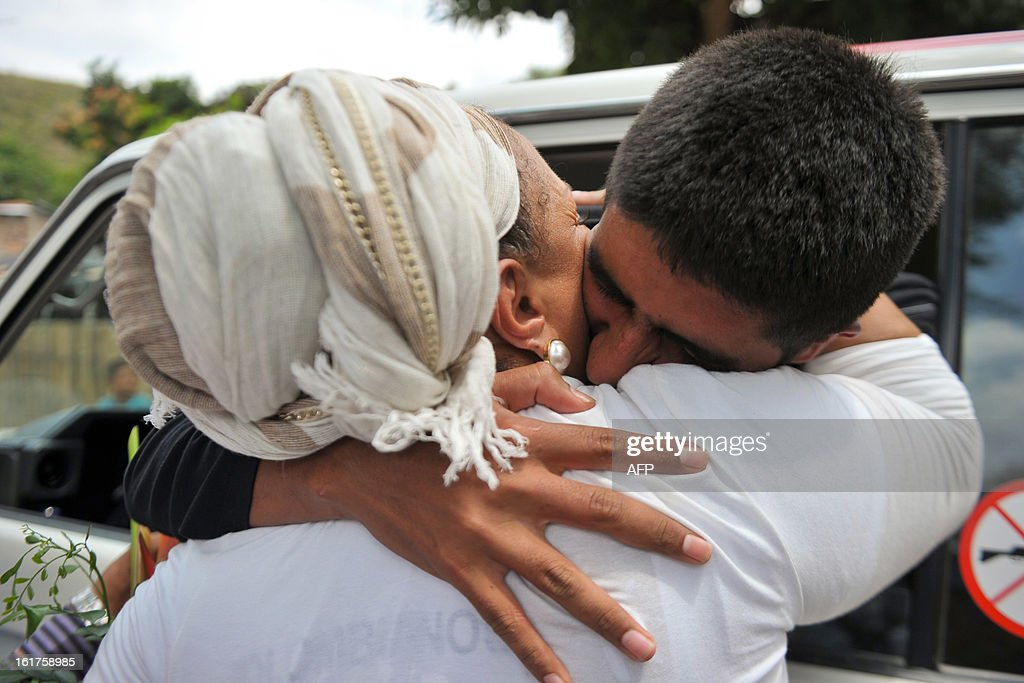 Released Colombian police officer Cristian Camilo Yate (R) gives a hug to former Colombian Senator Piedad Cordoba in the village Montealegre, Cauca department, Colombia, on February 15, 2013. Leftist Colombian guerrillas on Friday released two police officers they had held for three weeks, the International Committee of the Red Cross said. The men were released in a rural area in Cauca department in southwestern Colombia and were in good health, the ICRC said in a statement.
