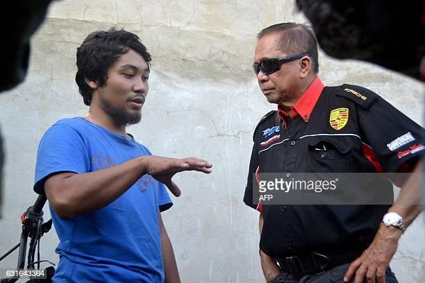 Released hostage Filipino crewman Glenn Alindajao talks to Jesus Dureza a senior aide to Philippine President Rodrigo Duterte at an airport in Jolo...