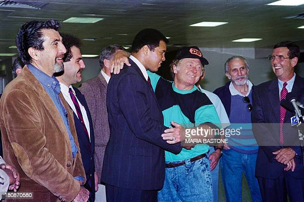 Released hostage Royce Smart gives former heavyweight World boxing champion Muhammad Ali a hug on December 04 1990 after his arrival t Kennedy...