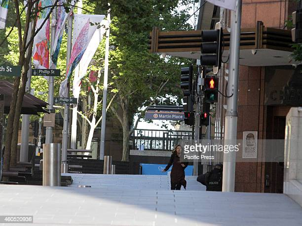 Released hostaged seen running towards the tactical team in Lindt Cafe Martin Place in the central business district of Sydney Australia Police...