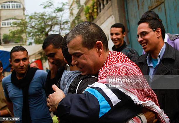 A released Palestinian prisoner Amr Masoud is welcomed by Relatives and friends in front of his house in AlShatea refugee camp in Gaza City on 30...