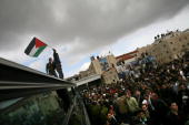 Released Palestinian prisoners are welcomed by family and friends as they arrive by bus at the Muqata headquarters on December 3 2007 in Ramallah...