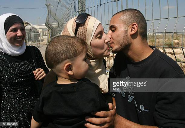 Released Palestinian teenager Zakaria Shurbaji is greeted by relatives at a military checkpoint near the northern West Bank town of Tulkarem on...