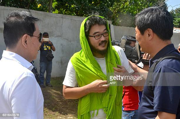 Released South Korean hostage Park Chung Hung the South Korean Ship Captain talks to local government officials at an airport in Jolo town in...