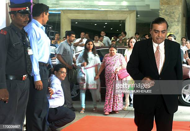 Reliance Industries Chairman Mukesh Ambani arrives followed by his wife Nita mother Kokilaben and daughter Isha for the company's annual general...