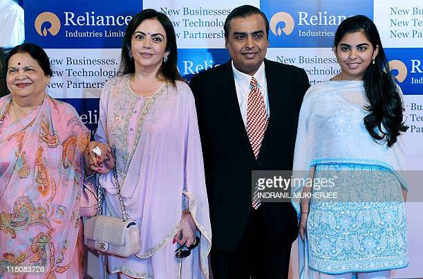 Reliance Industries Chairman Mukesh Ambani his mother Kokilaben wife Nita and his daughter Isha pose on their arrival at the company's annual general...