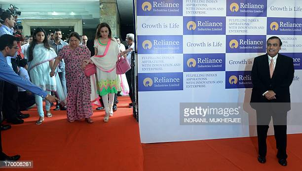 Reliance Industries Chairman Mukesh Ambani poses on arrival as his wife Nita his mother Kokilaben his daughter Isha and son Anant arrive at the...