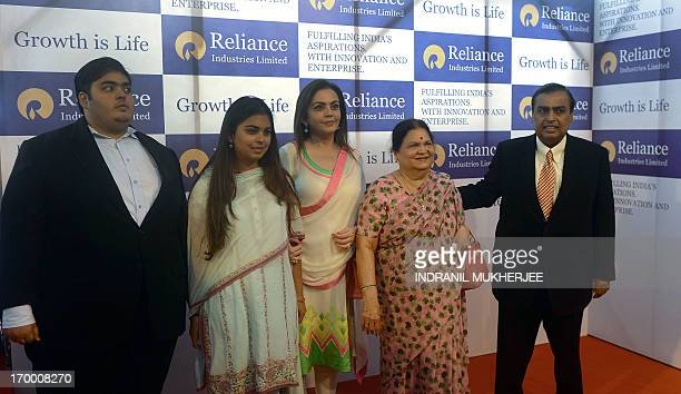Reliance Industries Chairman Mukesh Ambani poses with his mother Kokilaben his wife Nita his daughter Isha and son Anant on arrival at the company's...