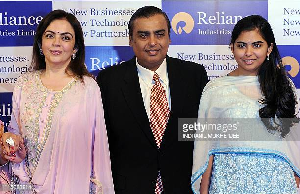 Reliance Industries Chairman Mukesh Ambani with his wife Nita and daughter Isha pose on their arrival at the company's annual general meeting in...