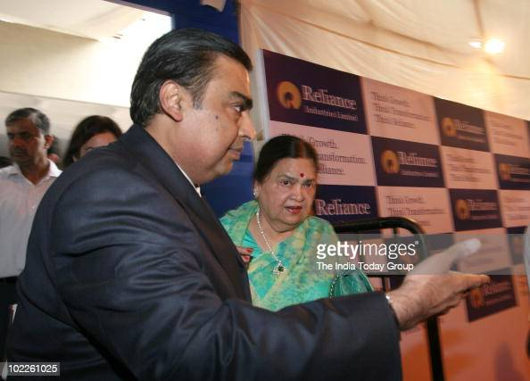 Reliance Industries Limited chairman Mukesh Ambani along with his mother Kokilaben poses for photographers before going into the AGM in Mumbai on...