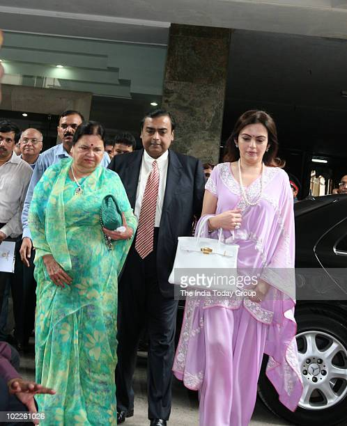 Reliance Industries Limited chairman Mukesh Ambani along with his mother Kokilaben and his wife Nita poses for photographers before going into the...