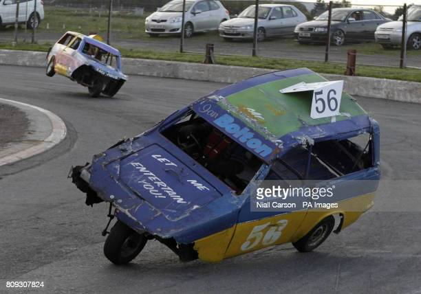 Reliant Robins tilt on to two wheels as they round the bends during the Reliant Robin heats at the stock car racing event at Nutts Corner Raceway in...
