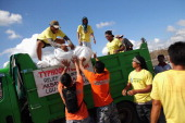 Relief aid is loaded on a truck at the Tacloban port on November 18 2013 in Leyte Philippines Typhoon Haiyan which ripped through Philippines over a...
