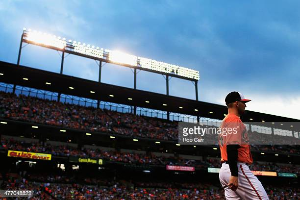 Relief Darren O'Day of the Baltimore Orioles walks to the bullpen before the start of the Orioles and New York Yankees game at Oriole Park at Camden...