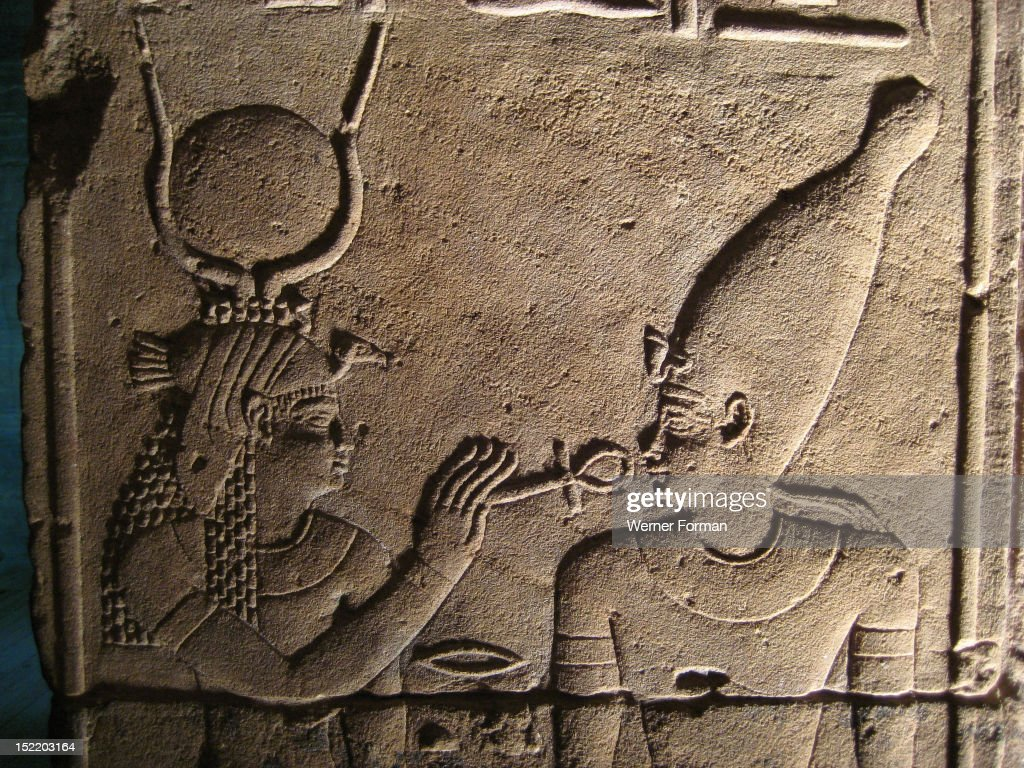 Relief from the inner sanctum wall of the Temple of isis depicting the goddess resurrecting Osiris with the ankh the Egyptian sign for life Egypt...