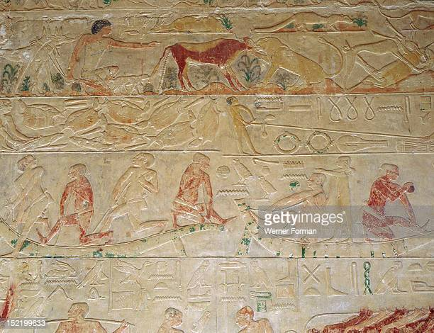 A relief from the tomb of the vizier Ptah hotep at Saqqara with scenes depicting the construction of a reed boat In the upper register the huntsman...