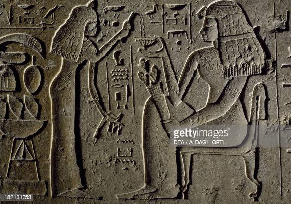 Relief inscribed with the name of Nubi depicting the deceased receiving the funeral offering of water and wine from his daughter Kiki who is standing...