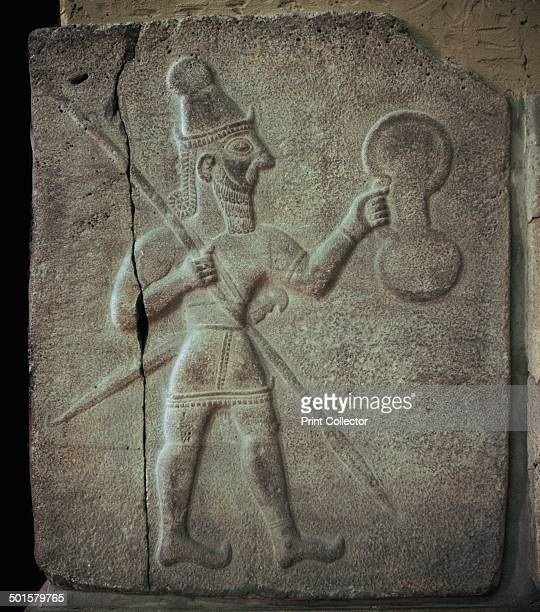 Relief of a Hittite warrior or wargod with shield spear and sword From the Pergamon Museum in Berlin