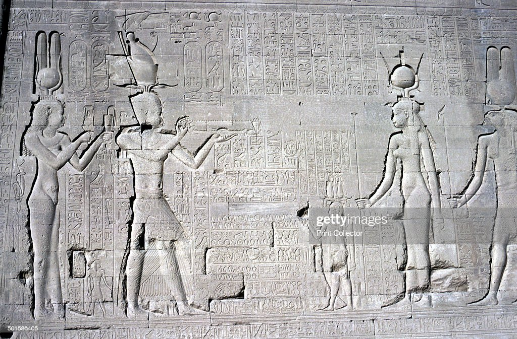 Relief of Cleopatra VII and Caesarion before Isis and Osiris Temple of Hathor dedicated to Hathor and Horus the Elder Abydos Egypt late Ptolemaic...