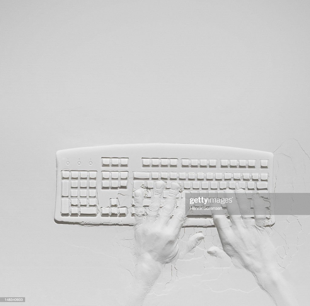 relief of hands on keyboard : Stock Photo